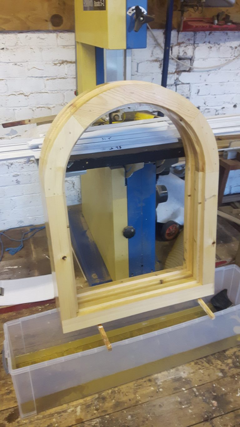 Arched Redwood Window